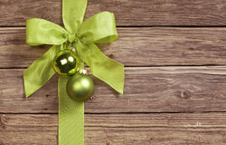 Decorative green bow on a wooden background Stock Image