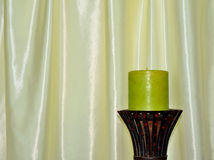 Decorative green candle with silk background Stock Image