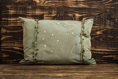 Decorative Green Pillow  on Blue Wooden Background Royalty Free Stock Image