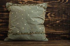 Decorative Green Pillow  on Blue Wooden Background Royalty Free Stock Photos