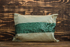 Decorative Green Pillow  on Blue Wooden Background Royalty Free Stock Photography
