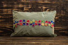 Decorative Green Pillow  on Blue Wooden Background Stock Photos