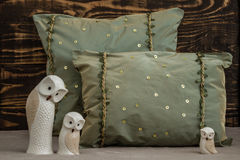 Decorative Green Pillows  on Brown Wooden Background Stock Photography