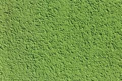 Decorative green plaster texture on the wall. Texture of the green stucco wall for background royalty free stock photo