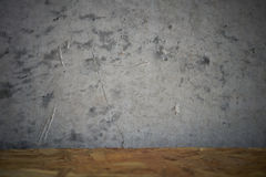 Grey oncrete wall with wooden table Stock Images
