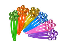 Decorative Hair Clips Six. Looking down at a row of six colorful flower hair clips Stock Image
