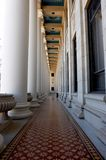 Decorative Hall. Hallway with ornate ceiling, floor, and pillars Stock Photos