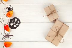 Decorative Halloween garland and craft goft boxes. Halloween decorations. Flat lay, top view trendy holiday concept, presents back. Ground Royalty Free Stock Image