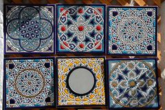 Decorative hand painted ceramic tiles for sale. Tiles based on classic moorish tiling artwork from Andalusia, Spain Royalty Free Stock Photos
