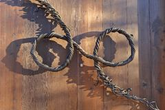 Free Decorative Handle Of Twisted Metal Wires On A Wooden Door Stock Photos - 44472793