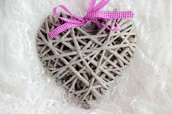 Decorative handmade heart made of wood on white laces Royalty Free Stock Photography