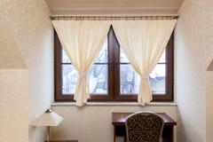 Decorative hangings in window. Decorative bright hangings in window in elegant room Stock Photo