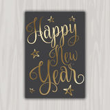 Decorative Happy New Year card. Happy New Year card design with decorative gold type Stock Photos