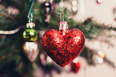 Decorative heart on christmas tree Royalty Free Stock Photos