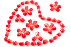 Decorative heart and flowers. Decorative heart of garnet grains Royalty Free Stock Photography