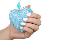Decorative heart in his hand with a nice manicure Stock Photography