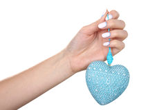 Decorative heart in his hand with a nice manicure Stock Photo