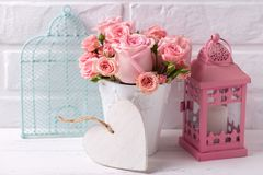 Decorative heart, pink roses flowers  in white pot, pink lantern Stock Photography