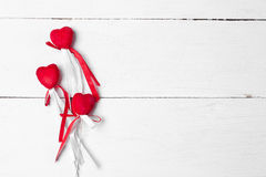 Decorative heart with satin ribbons on a stick. Stock Photo