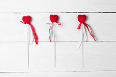 Decorative heart with satin ribbons on a stick. Stock Photos
