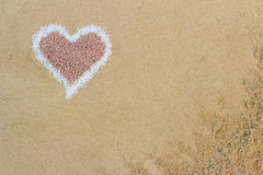 Decorative heart shape formed of sand. Symbolic of love and romance with copyspace for your Valentines Day, wedding or anniversary message Stock Photos