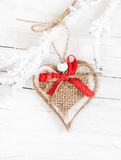 Decorative heart on snow-covered branch Stock Photography
