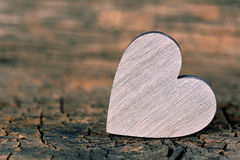 Decorative heart on a wooden background Stock Photo