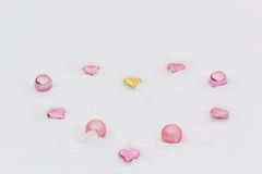 Decorative hearts and balls in the white snow Stock Photography