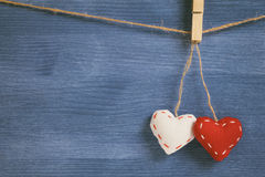 Decorative hearts hanging on the rope against blue wood wall Royalty Free Stock Image