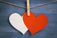 Decorative hearts hanging on the rope against blue wood wall Stock Photography
