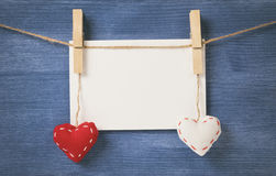 Decorative hearts hanging on the rope against blue wood wall Stock Images