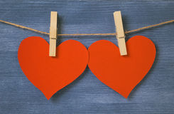 Decorative hearts hanging on the rope against blue wood wall Royalty Free Stock Photos