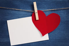 Decorative hearts hanging on the rope against blue wood wall Royalty Free Stock Images