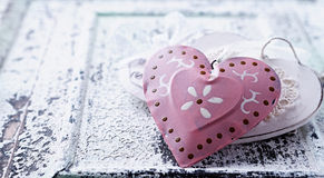 Decorative hearts on an old wooden background Stock Photos