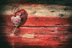 Decorative hearts on red wooden background Royalty Free Stock Image
