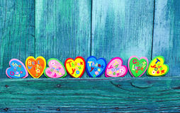 Decorative hearts on wooden background. Background valentines day with Decorative hearts on wooden background Royalty Free Stock Photo