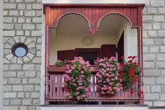 Decorative Home Balcony Garden With Petunia In The Basket Stock Photography