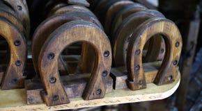 Decorative horseshoes made of wood stock images