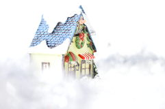 Decorative house in artificial snow. On white background Royalty Free Stock Image