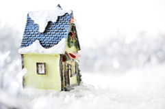 Decorative house in artificial snow. On white background Stock Photography