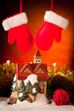 Decorative house christmas ornament with red gloves hanging Royalty Free Stock Photo