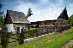 Decorative house in Cicmany in Slovakia. Cicmany, Slovakia - august 02, 2015: Old wooden houses in Slovakia village Cicmany, traditional painted with white paint Royalty Free Stock Photo