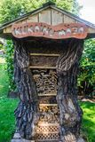 Decorative house made of hollow old wood for firewood stock photography
