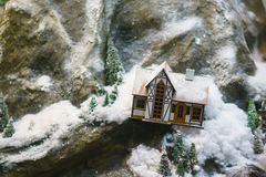Decorative house in the mountains, the layout. A decorative house in the mountains, the layout Royalty Free Stock Photography