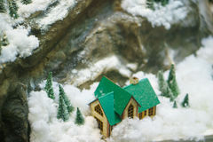 Decorative house in the mountains, the layout. A decorative house in the mountains, the layout Royalty Free Stock Image