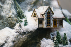 Decorative house in the mountains, the layout. A decorative house in the mountains, the layout Royalty Free Stock Photos
