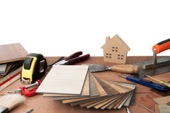Decorative house, paintbrushes, interior design. Construction materials, sample of materials. Copy space.Decoration materials for home and building materials are Stock Photography