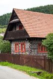 Decorative houses in village Cicmany. Cicmany, Slovakia - august 02, 2015: Old wooden houses in Slovakia village Cicmany, traditional painted with white paint Royalty Free Stock Images