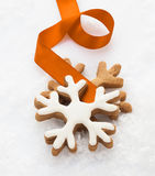 Decorative iced snowflake biscuit Stock Images
