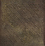 Decorative imprinted grungy parchment Stock Images